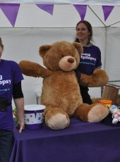 Young Epilepsy stall with big bear raffle prize