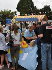 9 - Visitors congregate around the Duck Race stall