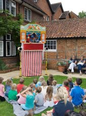 32 - Punch & Judy entertain the children while the parents have a rest