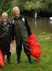 Gerry Acher & Nicholas Owen bring two more bags of ducks ashore