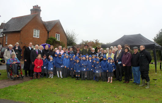 Local residents, dignitaries and St Matthews School children after the unveiling