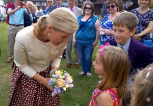 Sophie Perkins presents Her Royal Highness with a posy of flowers