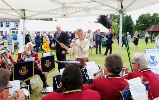 To the delight of the crowds Her Royal Highness swapped places with Glenn Hayter, the Cobham Band's Conductor and briefly took over the baton to conduct the Band